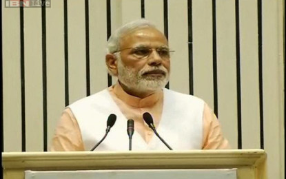 Modi UPDATE 2-India diluted bill lands, earn lower house vote